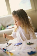 Little Girl Painting Cookies